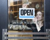 Woman Opening a Coffee Shop --- Image by © Royalty-Free/Corbis